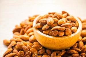 Almonds nut in wooden bowl