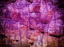 Primer plano de la pared de piedra o roca de fondo o textura