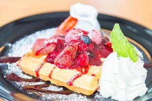 Strawberry and mix berry on top of waffle