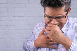 Close up of man coughing photo