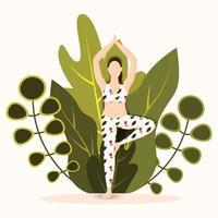 mujer practicando postura de árbol asana