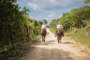 2016- Two cowboys riding on the road photo