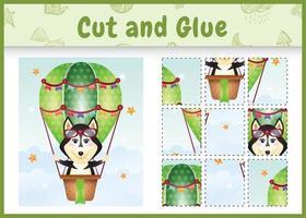 juego de mesa para niños cortar y pegar con un lindo perro husky en globo aerostático vector