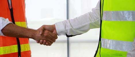 Handshake of engineers in the construction site