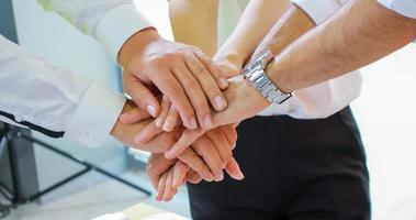 Business people brainstorming stacking hands together photo