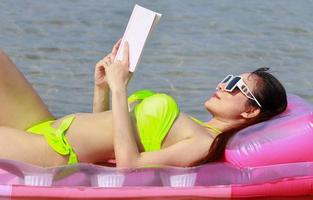 Beautiful Asian girl happy and relaxed on summer vacation photo
