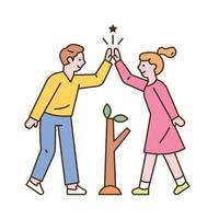 A man and a woman are planting seedlings and high five. vector