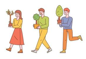 Three people are carrying a tree planted in a small pot. vector