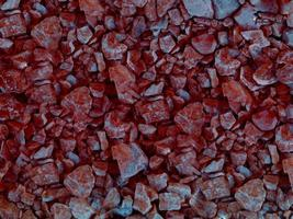 Close-up of red stone or rock wall for background or texture photo