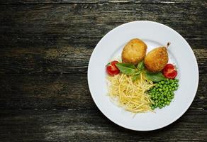 Kiev cutlets with bone, green beans and noodles