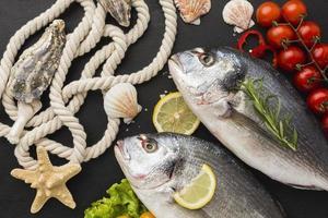Fish arrangement with lemon top view