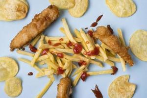 Flat lay delicious fish chips concept