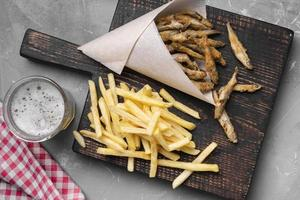 Flat lay delicious fish chips concept photo