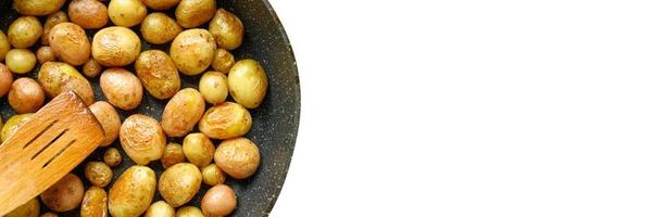 Golden roasted potatoes in the skin photo