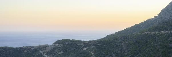 Dusk mountain landscape with views of the Mediterranean sea