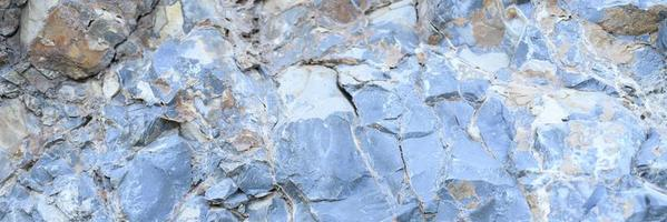 Texture of the surface of gray blue natural stone rocks photo