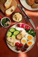 Mediterranean style breakfast plate on terracotta background photo
