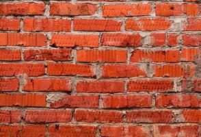 Uneven red brick wall background