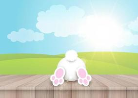 Easter background with a cute bunny on a wooden table vector