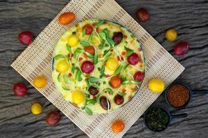 Homemade veggie pizza with cherry tomatoes