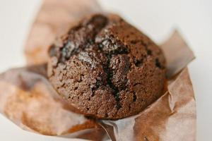 Cupcake with dark chocolate in paper wrapper