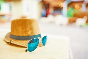 Hat and glasses on the table photo