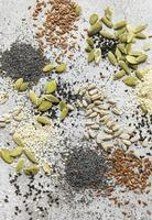 Mix of different seeds for a healthy salad photo