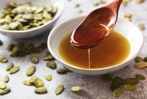 Bowl with pumpkin seed oil photo