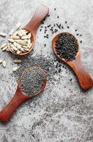 Wooden spoons with various healthy seeds