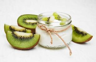 Kiwi yogurt on a table photo