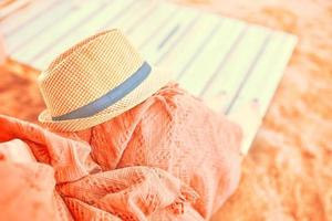 Straw hat on a hot day off photo