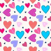 Repeated hearts drawn by hand. Scandinavian seamless pattern with colored cute love heart isolated on white background. Endless romantic. Vector illustration. Perfect for fabric or childish design