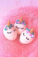 Easter eggs unicorns in nest photo