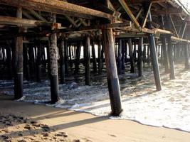 Under a boardwalk pier by the ocean