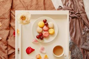 Romantic breakfast in bed with macaroons photo