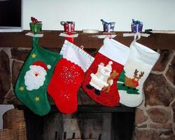 Christmas stockings hanging on a fireplace photo