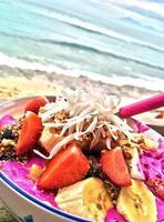 A bowl of pitaya by the beach photo