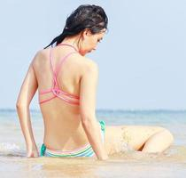 Beautiful Asian woman happy and relaxed on a summer vacation photo