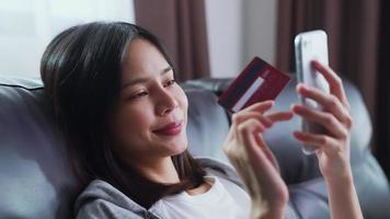 Woman holding smartphone and credit card video