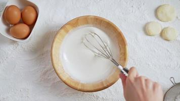 Close-up of Hand Whisking on Flour