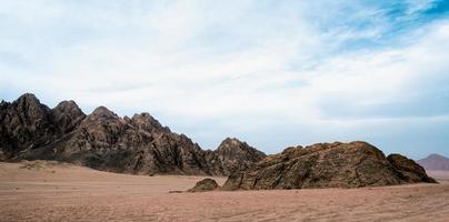 Rocks in sand in a desert photo