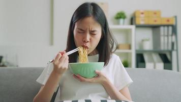 Woman Watching Movies While Eating Noodles video
