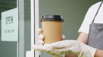 Gloved Hands Holding a To-Go Beverage video
