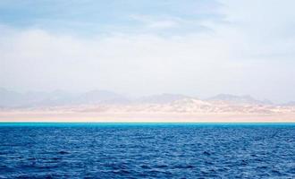 Hazy coast view from the ocean photo