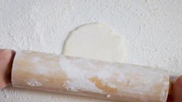 Rolling Pin Working With Dough On Flour