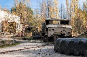 Pripyat, Ukraine, 2021 - Old abandoned wrecked vehicle in Chernobyl photo