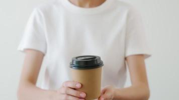 Hands Holding a Brown Paper Coffee Cup video