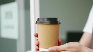 Hands Holding Brown Takeaway Coffee Cup video
