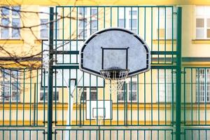 Basketball hoop on the school field photo