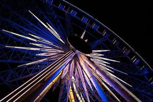 Carnival ferris wheel at night